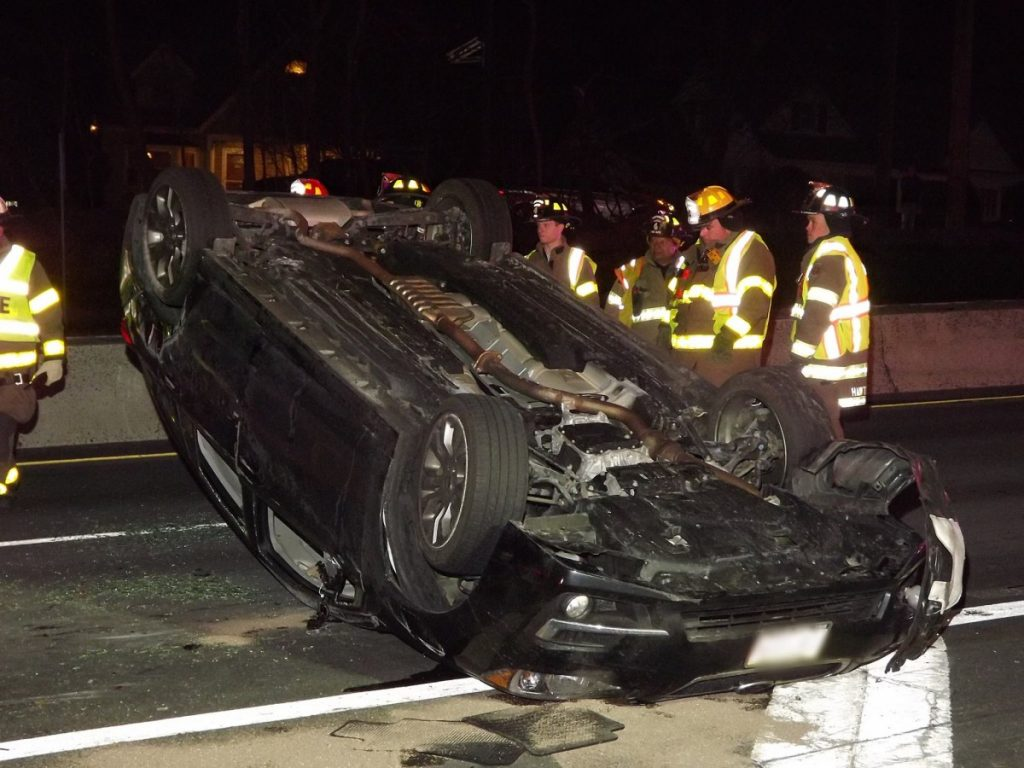 Rollover crash involving two (2) vehicles on Route 208