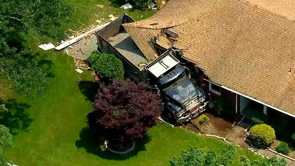 Runaway dump truck crashed into a single family home in Hawthorne