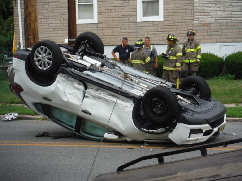Two vehicle rollover crash